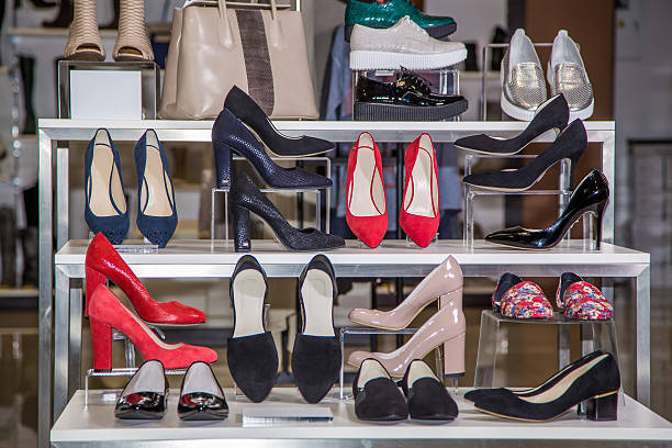 Large selection of women's shoes on the shelf stock photo