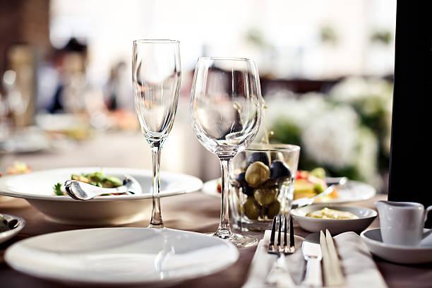 a large set of empty glasses in a restaurant - glas porslin bildbanksfoton och bilder