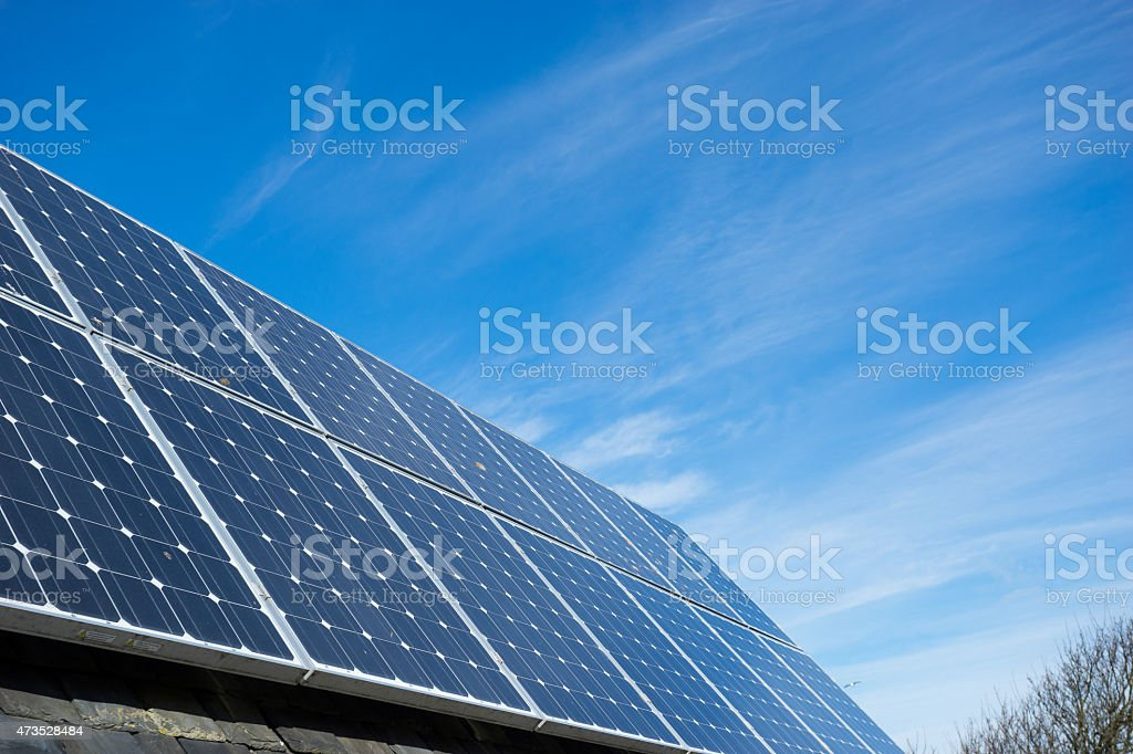 Large set of solar panels on a roof stock photo