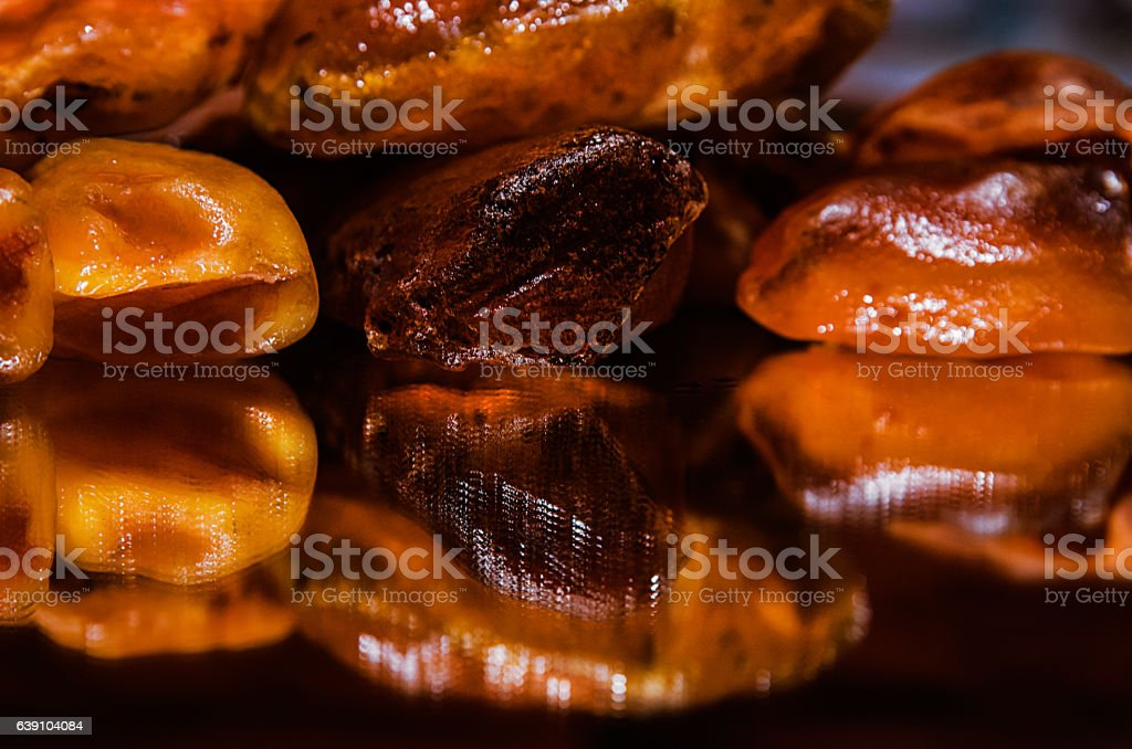 Large shiny stones Baltic amber reflected in the mirror. stock photo