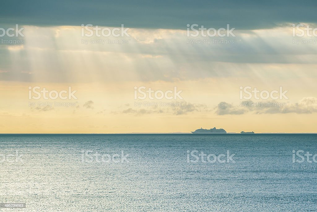 Large ship sailing across the water strip stock photo