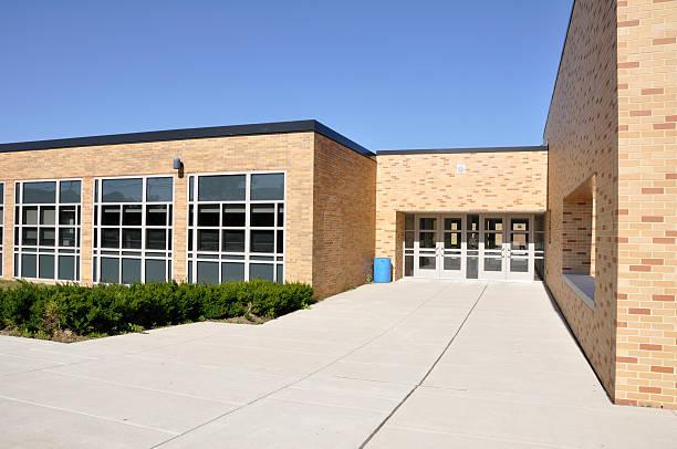 large sidewalk by school building stock photo