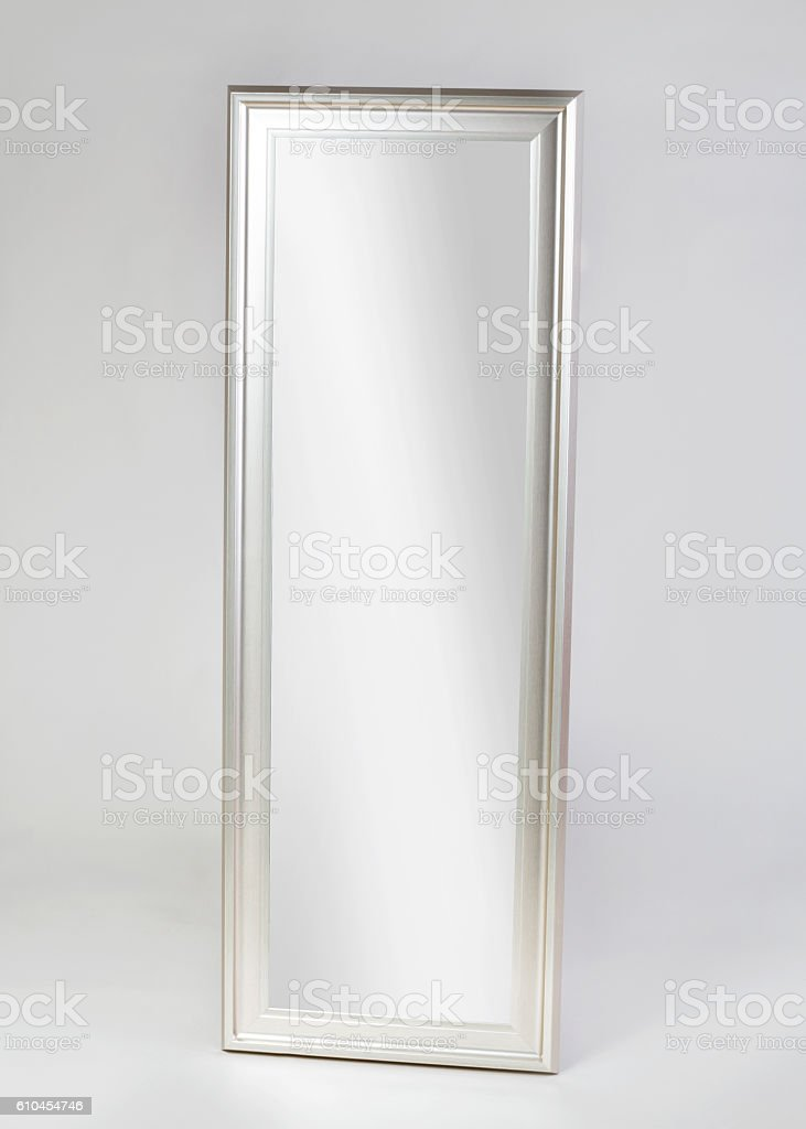 Large silver framed modern mirror stock photo