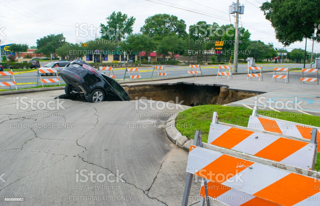 Large Sinkhole Swallows a Car in Florida stock photo