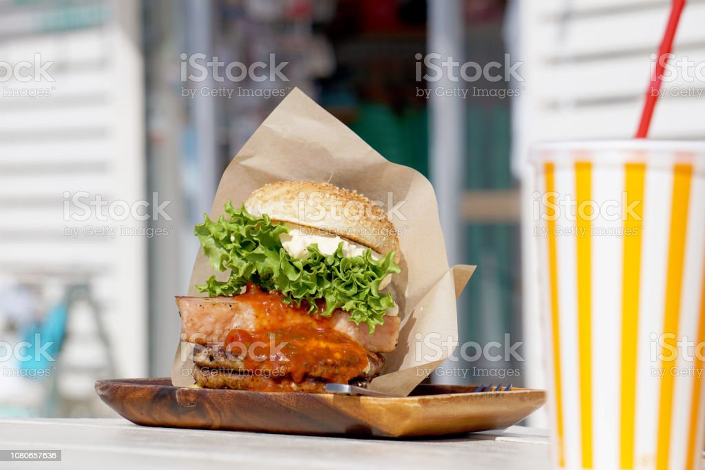Okinawa-style hamburger is known as large size, full of beef patty...