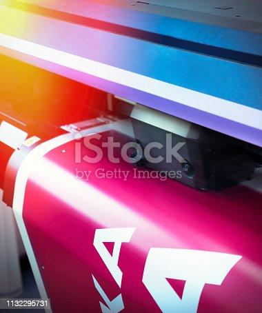 Detail of a large size printer inkjet plotter printing