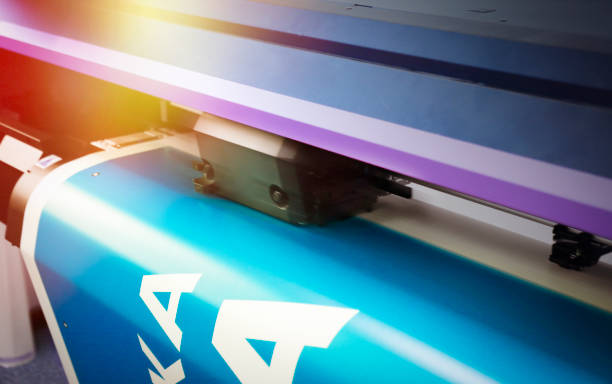 Large size printer printing Detail of a large size printer inkjet plotter printing printing plant stock pictures, royalty-free photos & images