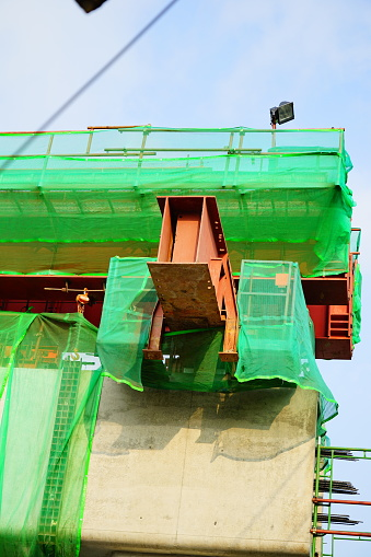 Close-up Large sized Straight red steel welded truss in construction side