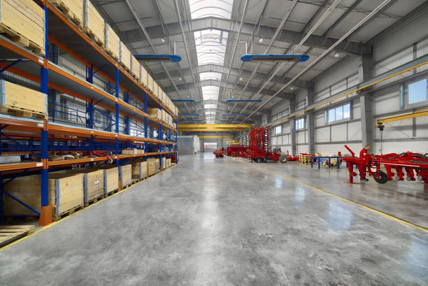 Large, spacious assembly shop. High storage racks with wooden boxes Large, spacious assembly shop. High storage racks with wooden boxes. warehouse interior stock pictures, royalty-free photos & images