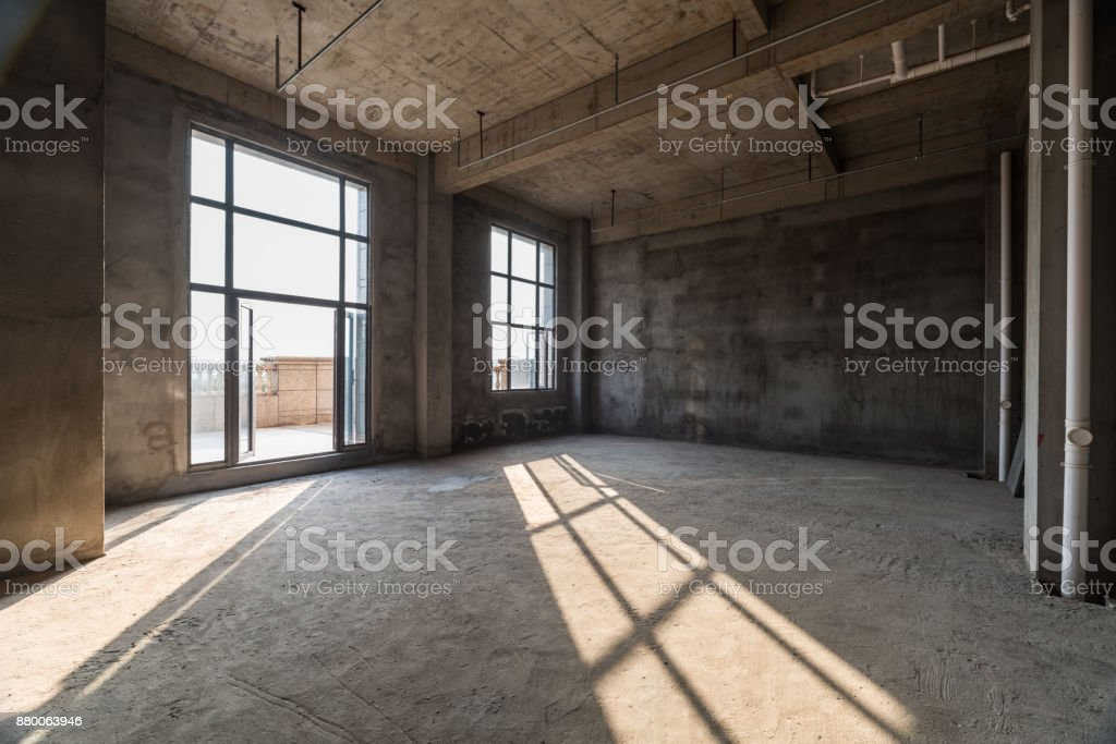 large spacious room, illuminated by natural light from windows,Empty interior space, stock photo