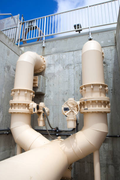 Large Split Piping at a Wastewater Treatment Plant stock photo