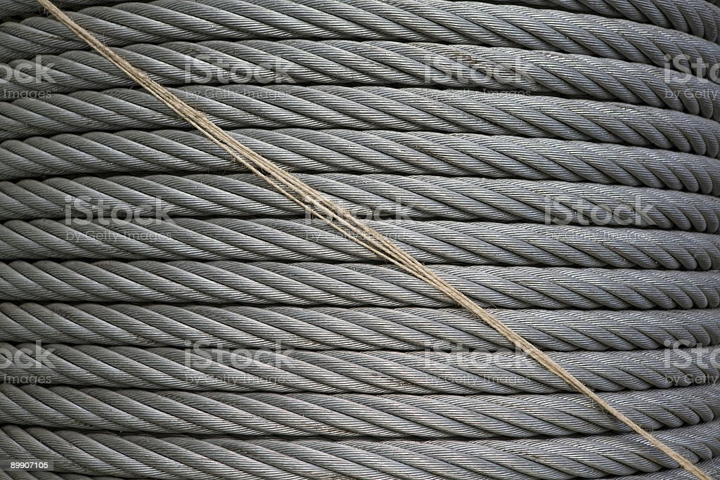 Large spool of metal cable with twine royalty-free stock photo