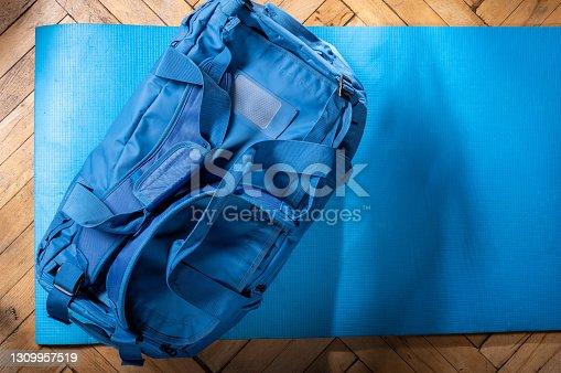 Large sports bag on a blue background. Large luggage bag.