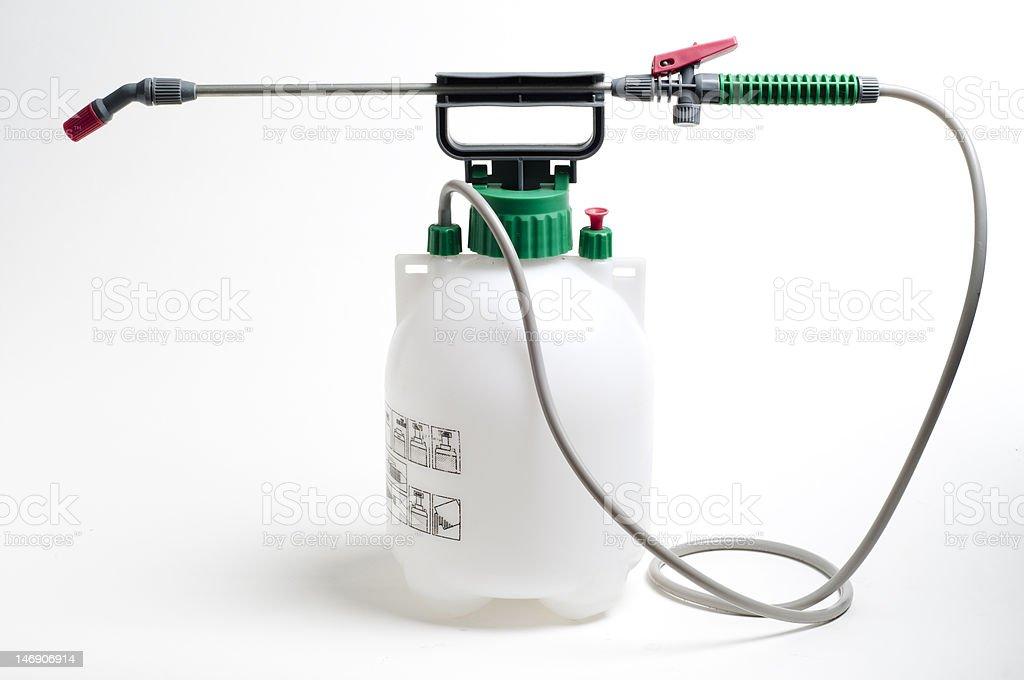 Grande contêiner e bicos de spray usado para jogando produtos químicos - foto de acervo