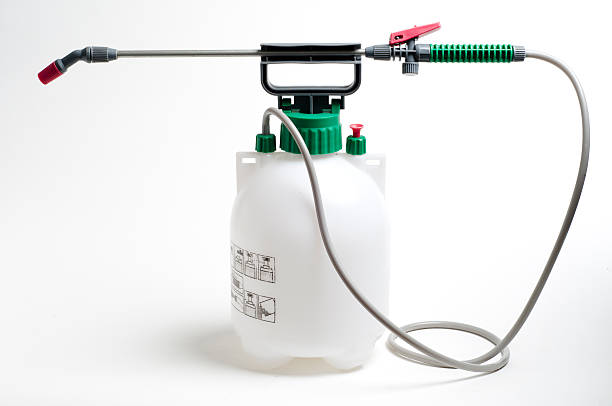 Large spray container and nozzle used for spraying chemicals Large spray container and nozzle used for spraying chemicals crop sprayer stock pictures, royalty-free photos & images