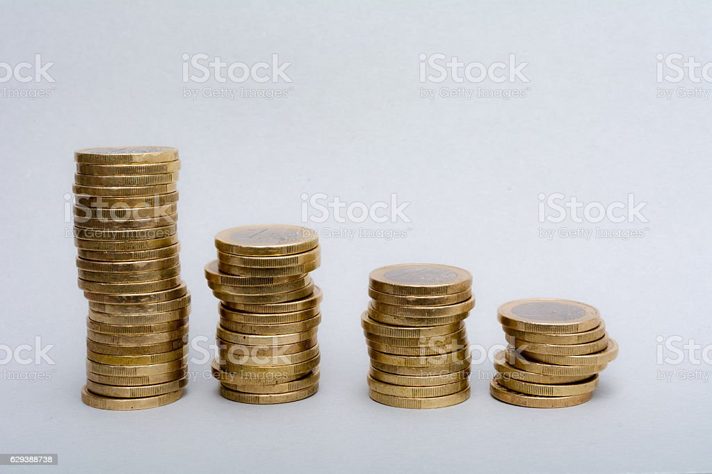 Large stack of euro coins in linear descending bar chart stock photo
