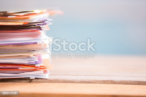 istock Large stack of files, paperwork. Close-up. Desk, office. Nobody. 533425381