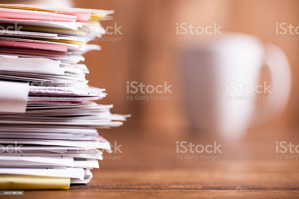 Large stack of files, paperwork. Close-up. Desk, office. Nobody. stock photo