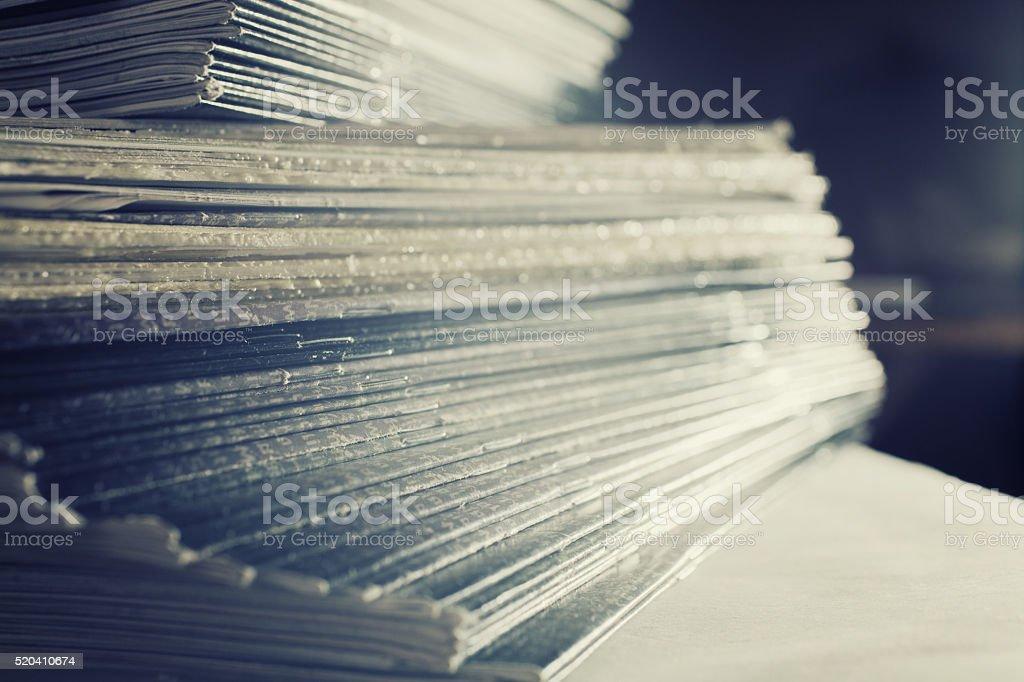 Large stack of magazines stock photo