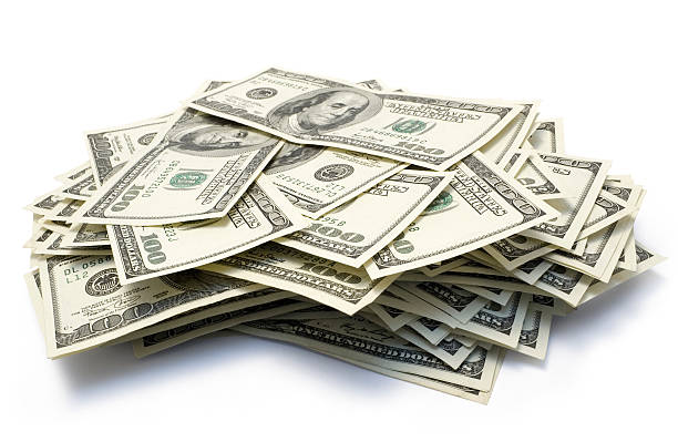 Large stack of one hundred dollar bills stock photo