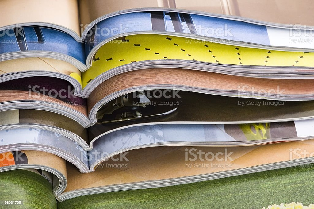 A large stack of open magazines royalty-free stock photo