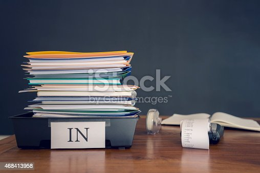 istock Large stack of paperwork and files with calculator. 468413958