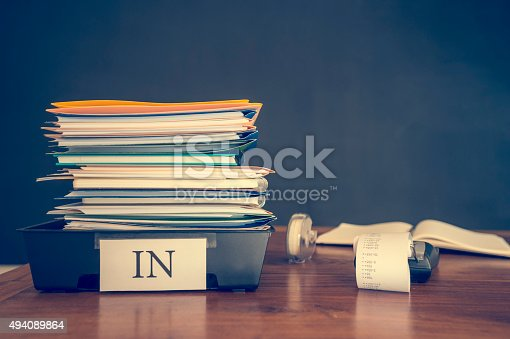 istock Large stack of paperwork and files with calculator. 494089864