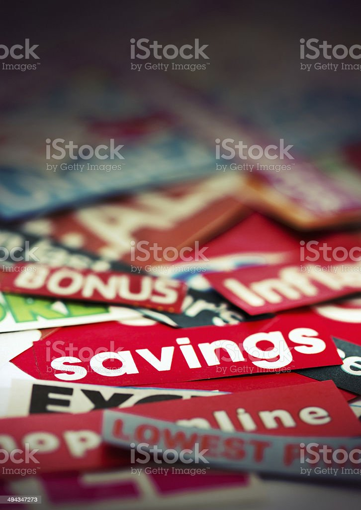 Large stack of press cuttings about savings and price cuts stock photo