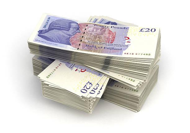 Large stack of twenty pound notes stock photo