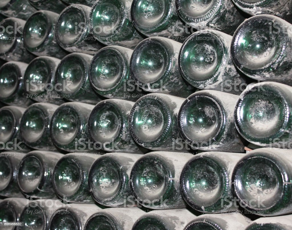 large stack of wine bottles in winery stock photo