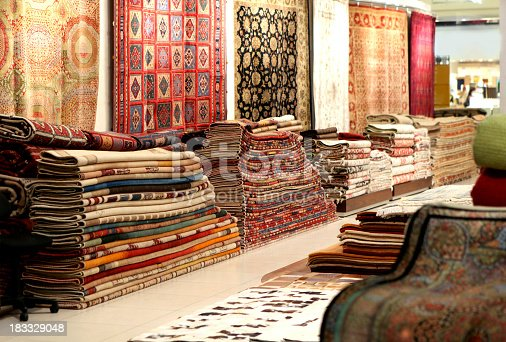 colorful collection of carpets and rugs folded and displayed..More in the Arabia Related lightbox..