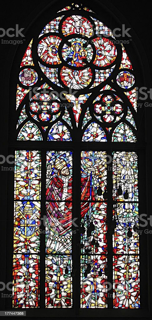 Large stained-glass window with religious imagery stock photo