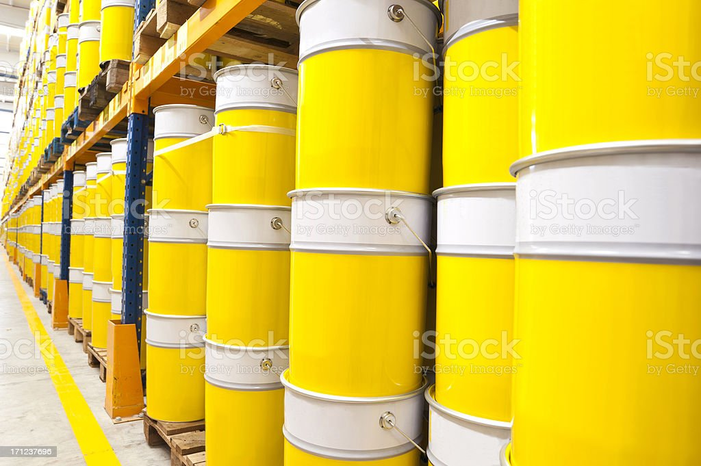 A large stock of industrial sized paint cans stock photo