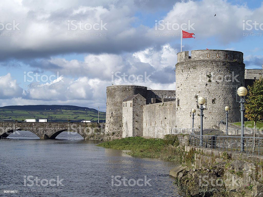 Large stone castle with bridge and a red flag  stock photo