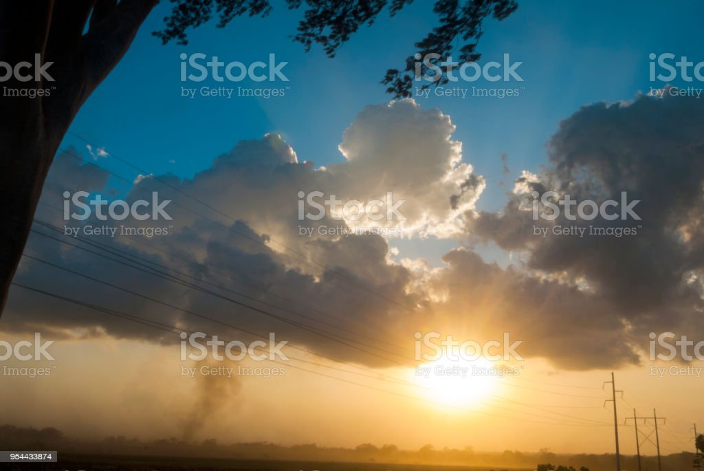 Large storm clouds over a field in Guatemala stock photo