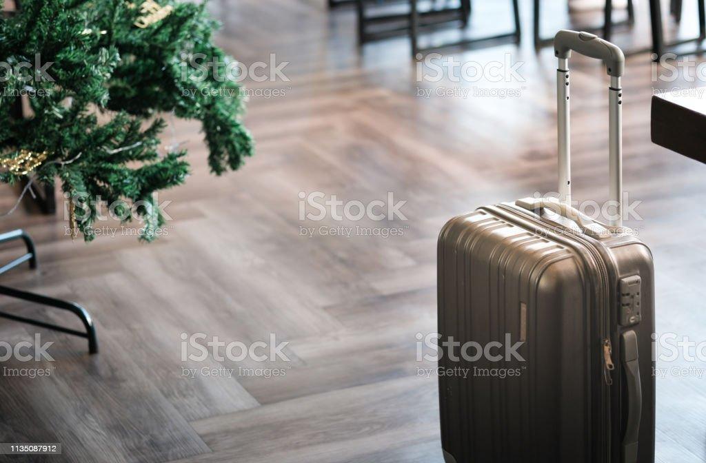 Large suitcases stand in the lobby of the hotel on the background