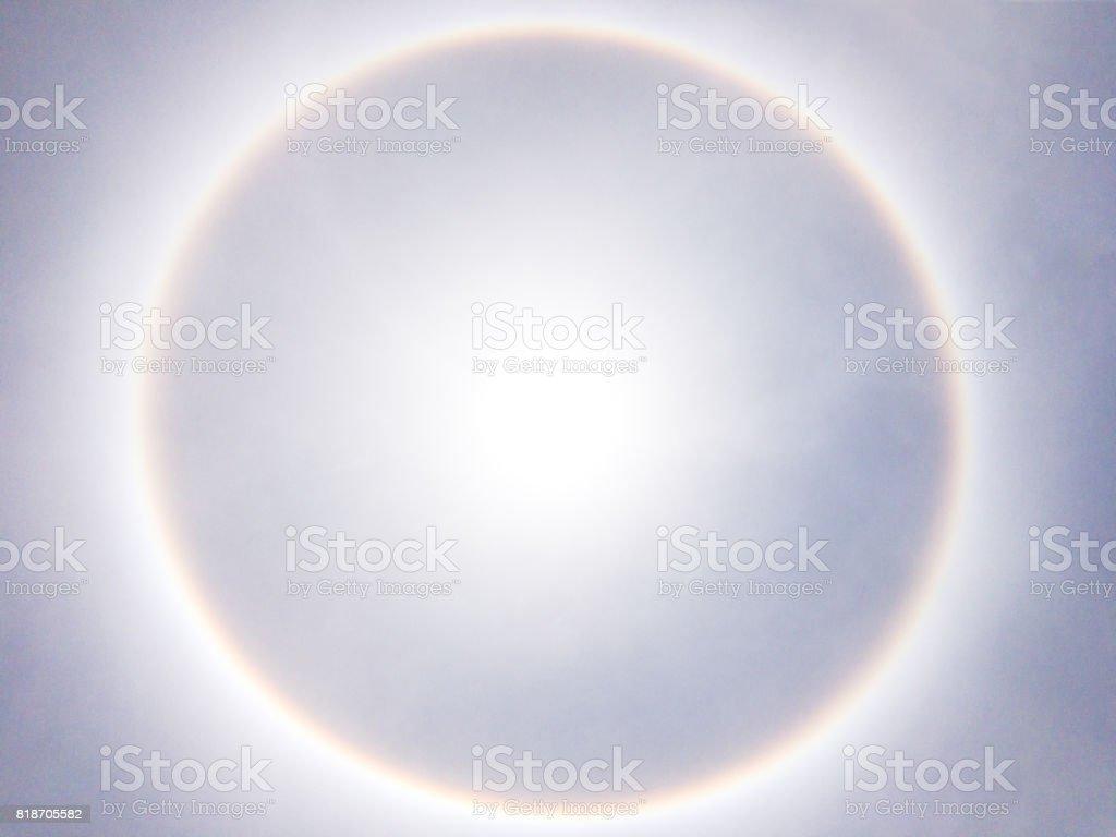 Large sun halo on the clear blue sky. stock photo