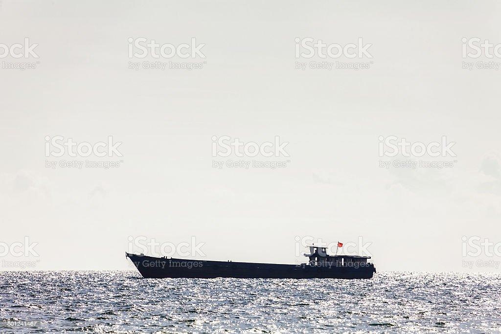Large black tanker ship in open sea