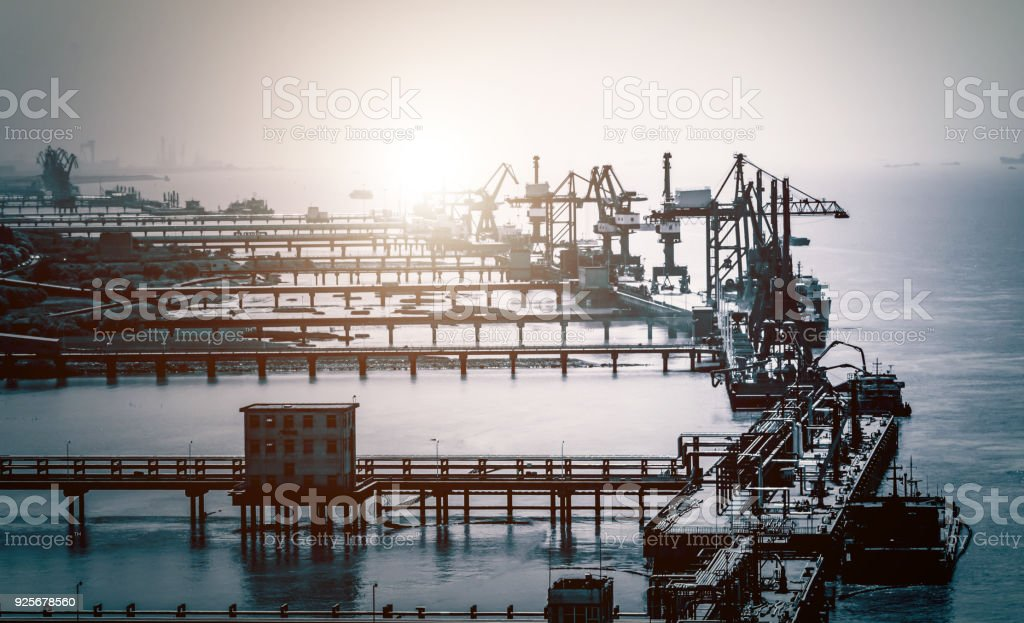 large tankers unloading crude oil stock photo
