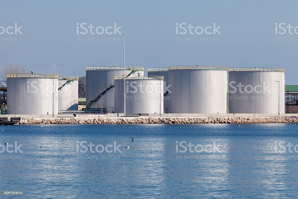 large tanks for petrol and oil, blue sky stock photo