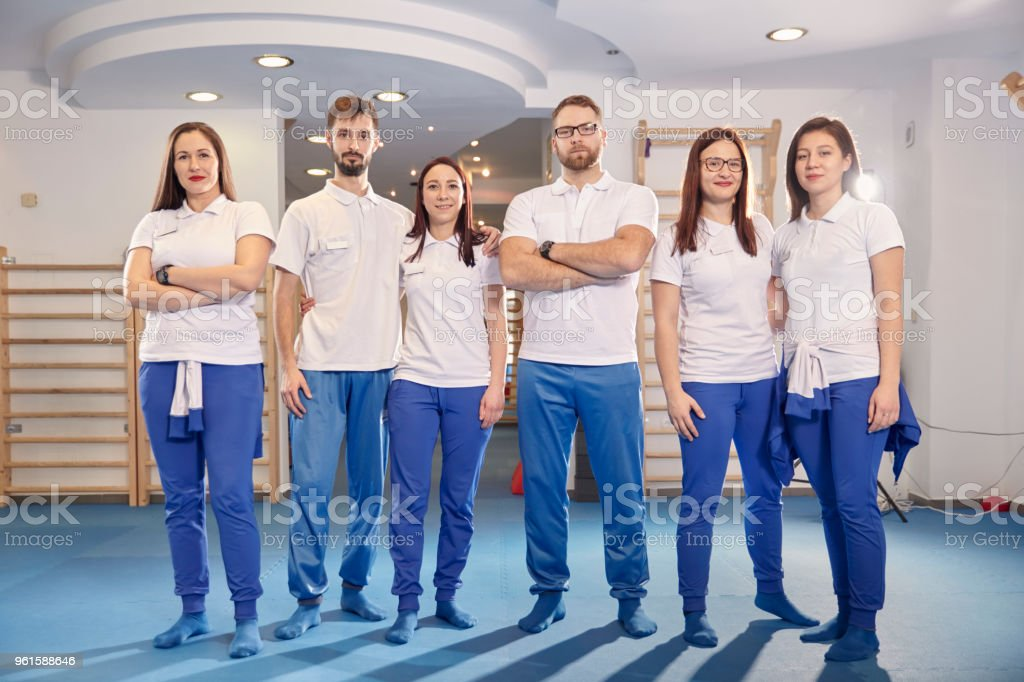 large team, group of physiotherapists  workers posing, work room indoors. stock photo