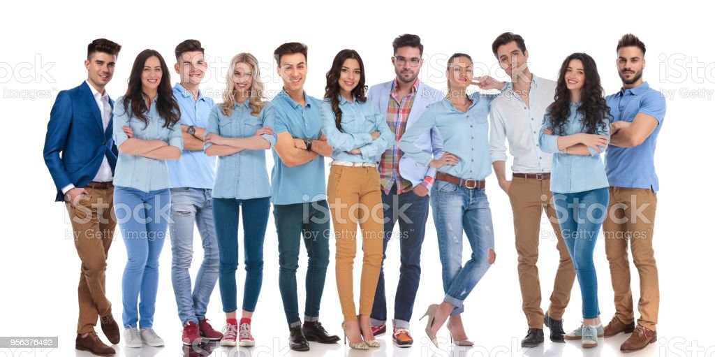 large team of casual men and women standing together stock photo