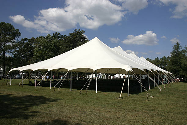 Large tent set up on the lawns for banquet Large Canvas Tent for an outdoor church service tent stock pictures, royalty-free photos & images