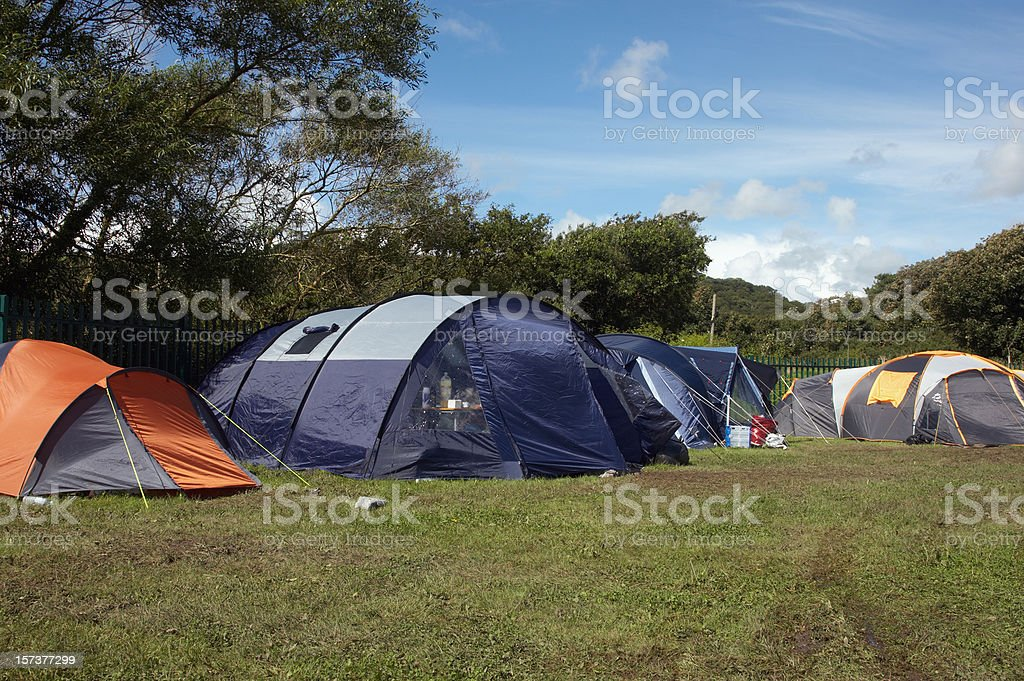 Large tents pitched in field royalty-free stock photo