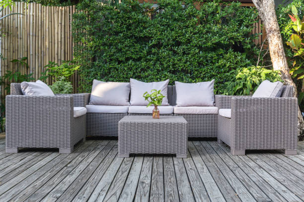 Large terrace patio with rattan garden furniture in the garden on wooden floor. Large terrace patio with rattan garden furniture in the garden on wooden floor wicker stock pictures, royalty-free photos & images