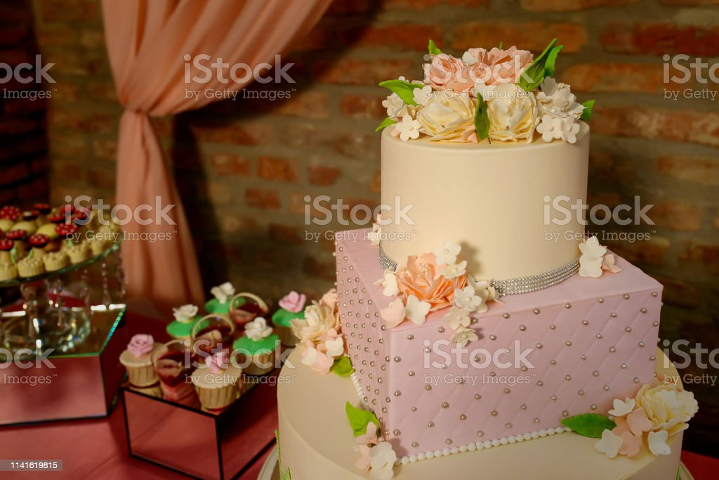 Large assortment of bite-sized cakes and a large three tiered cake...