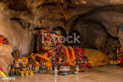 istock large tiger sculpture with religious attributes in a tiger cave in Krabi, Thailand 909806032