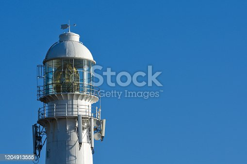 615497916 istock photo Large Torch Light On Slangkop Lighthouse Tower 1204913555