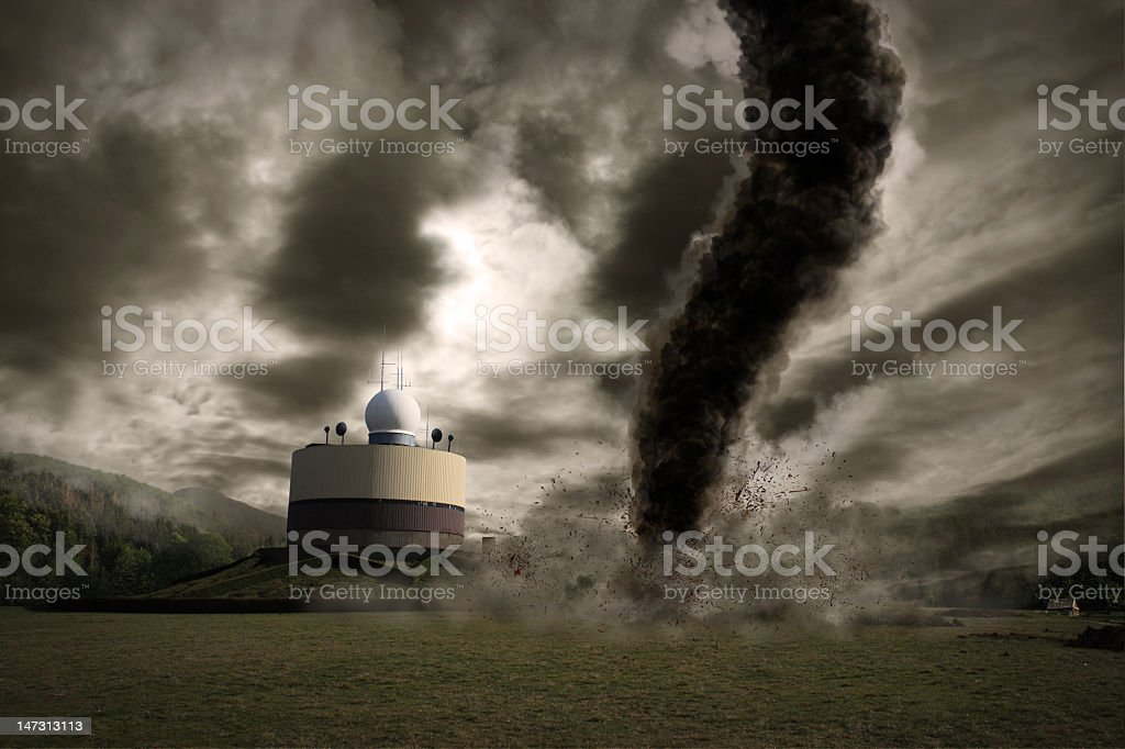 Large tornado over a meteo station in gray royalty-free stock photo