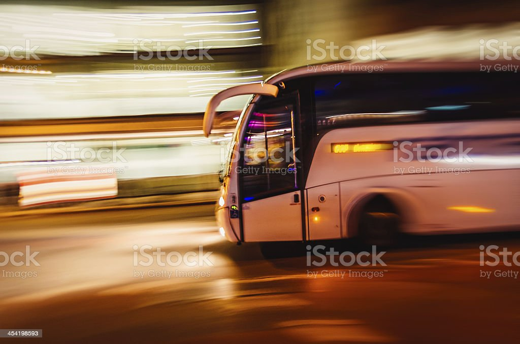 Large Tourist Bus Travels Fast In The City stock photo